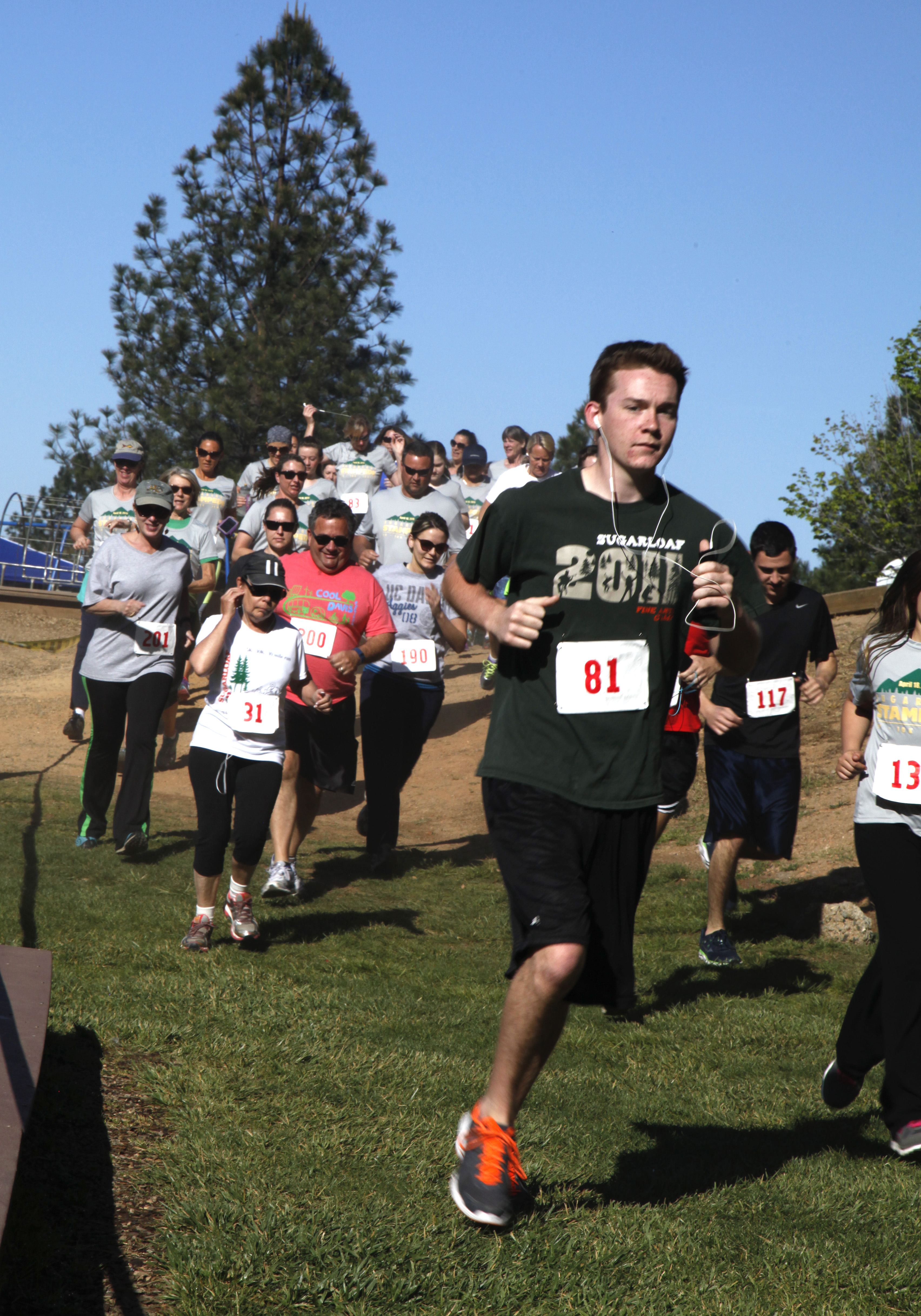 Runners stampede to raise money for camp scholarships