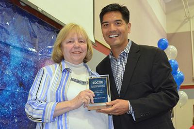 Carolyn Strelo-Smith stands with County Superintendent of Schools, Dr. Ed Manansala, and receives the Excellence in Education Award for the 2016-2017 school year.