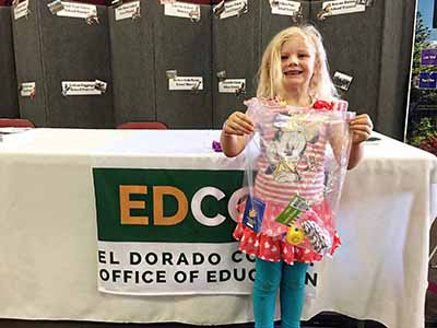 El Dorado County student receives prize at the El Dorado County Office of Education Education booth