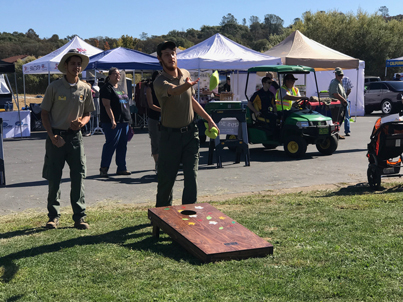 Guests enjoying the EDCOE corn hole activity at the Cops & Rodders Show and Shine Fly-In