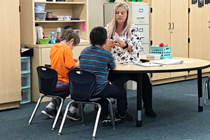 Dana Mendonca, Instructional Assistant Autism, teaches students at Rescue Elementary School socialization and word association.