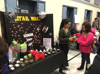 Olivia Kaihe, Best Marketing Winner, displaying her themed cupcakes