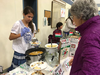Chloe Messer, seventh grade, serving traditional Hungarian cuisine
