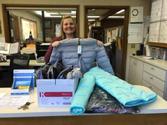 EDCOE delivers boxes of winter coats to schools across the county to keep children in need warm this winter.