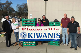 Placer Food Bank generously delivers pounds of food to the Green Valley Community Church for Kiwanis members to organize into large boxes for families in need. Left to right: Jorge Lupercio (Placer Food Bank), Jean Meyer (Kiwanis), Mary Shoenberger (Placer Food Bank), Rick Van Scoy (GVCC), Carl Hagen (Kiwanis), and Dave Martinez (Executive Director of the Placer Food Bank).