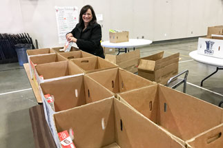 Brenda Higgins, EDCOE Food Service Supervisor, helped to fill 100 boxes full of food for families in need.