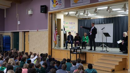 District Attorney Vern Pierson discusses the Project LEAD program with Sierra School students at the Civic Learning Award of Merit presentation assembly.