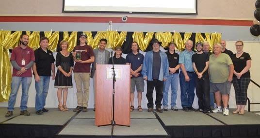 """EDCOE Facilities & Maintenance team is presented the 2018 """"Excellence in Education Award"""" from Dr. Ed Manansala, County Superintendent of Schools."""