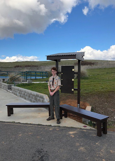 Eagle Scout, Thomas Ridgeway, stands with his Eagle Scout project at the El Dorado Community Observatory