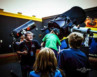 Visitors to the Community Observatory enjoy using the telescopes