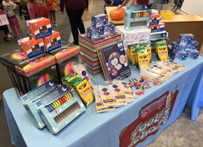 Pictured: Table of donated school supplies.