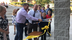 Pictured (left to right): Tagg Neal, Rescue Union School District Board Member, and Tony DeVille Jr. cut the ribbon to dedicate the new building.