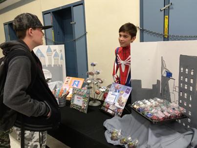 Hunter Tranum, seventh grade, best marketing winner, displaying his themed chocolates