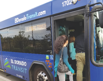 man and woman enter an El Dorado Transit bus