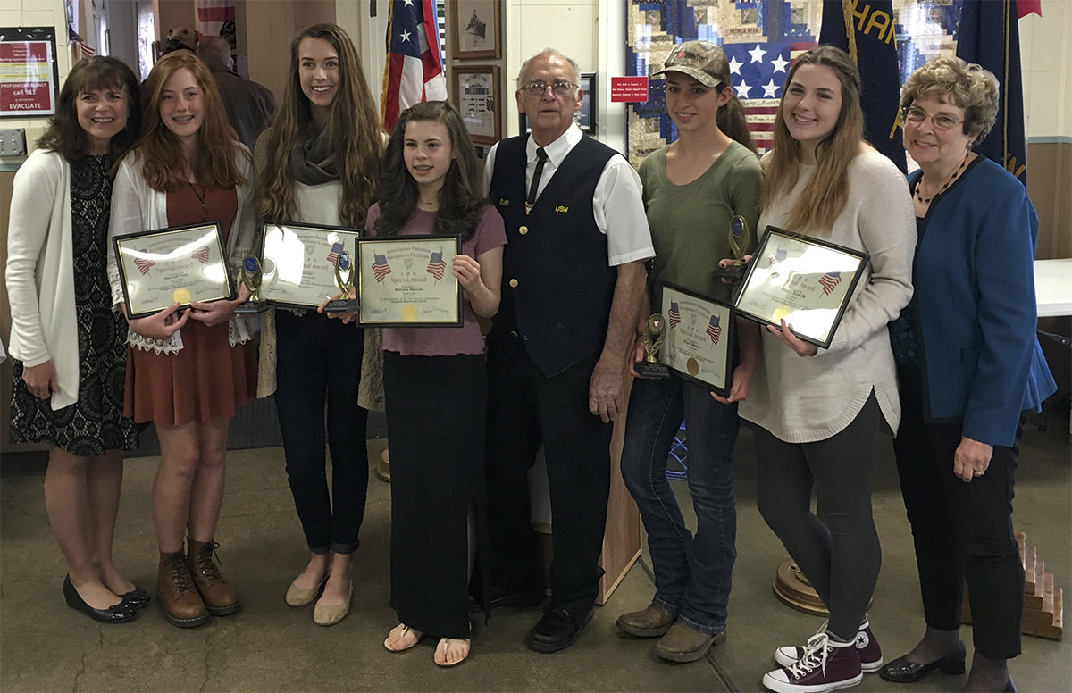 Photo:  Distinguished students at Charter University Prep are recognized for their gifted writing at a dinner hosted by the Fleet Reserve Association.  Left to right:  WilleJune Eggert, Hannah Frost, Julianna Eggert, Abriana Steward, Bud Sweet, Elise Johnson, Macey Deruelle, & Cherri Whiteley